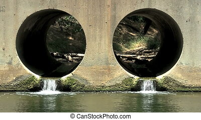 Drainage Tunnels - Water flowing through drainage tunnels.
