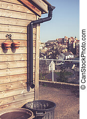 Drainpipe collecing rain water - Shed with drain and bucket...