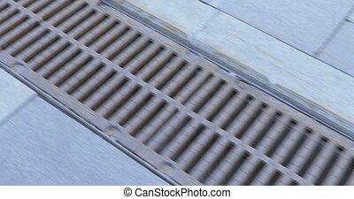 Drains of urban sanitation - Metal gratings of city drainage...