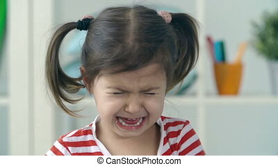 Drama Queen - Portrait of little girl crying and sobbing