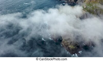 Dramatic aerial view of the Slieve League cliffs in County Donegal, Ireland.