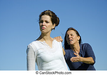Dramatic argument between mother and daughter. - Mother and...