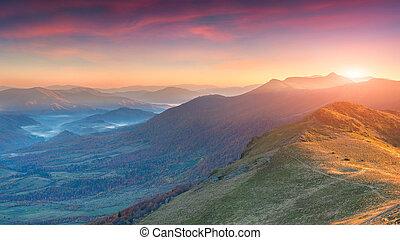 Dramatic autumn sunset in the mountain
