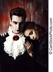 dramatic - Beautiful couple of vampires dressed in medieval...