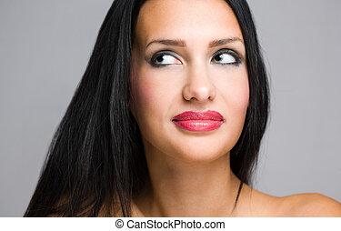 Dramatic beauty. - Portrait of a dramatic brunette beauty in...