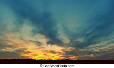 Dramatic billowing clouds at sunset sky at sunset. - Clouds...