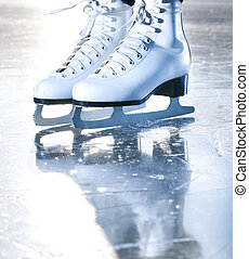 Dramatic blue portrait shot of ice skates