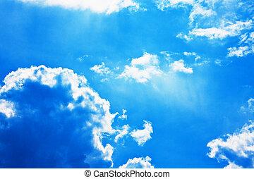 Dramatic blue sky with cumulus clouds