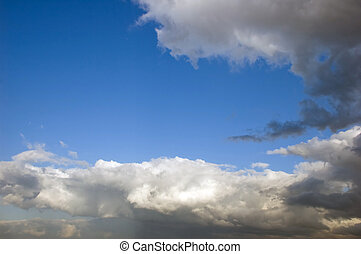 Dramatic Clouds against a blue sky background - Blue sky and...