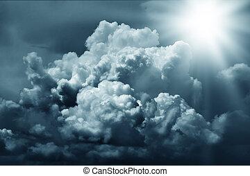 Dramatic clouds in the dark sky
