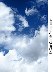 Dramatic clouds over blue sky