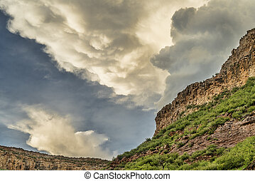 Dramatic clouds over sandstone clif