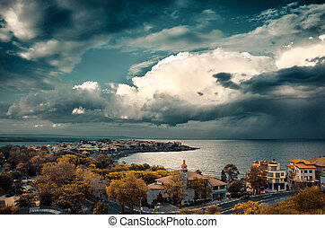 dramatic clouds over the sea and peninsula in sozopol,...