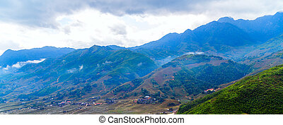 Dramatic clouds sky, natural landscape mountain range at foggy summer morning, green nature background aerial view.