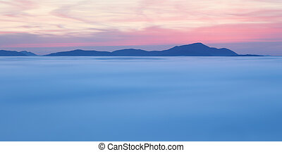 Dramatic clouds with mountain silhouette in dawn, Slovakia.