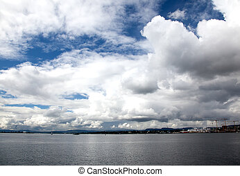dramatic cloudscape in the harbor of Oslo