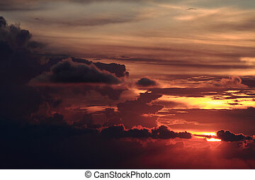 Dramatic colorful sunset with heavy dark clouds