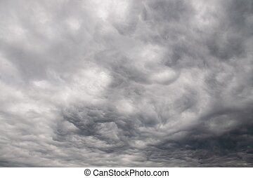 Dramatic gray clouds in the rainy sky