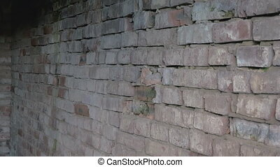 Grey Brick Wall with old destroyed blocks. Dark Dramatic video footage in High quality Ultra HD 4k.