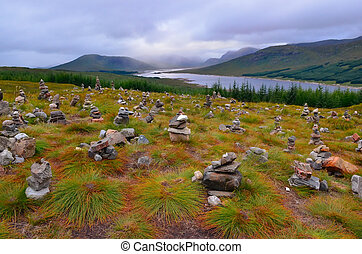 Dramatic landscape view of Scottish highlands and the lake