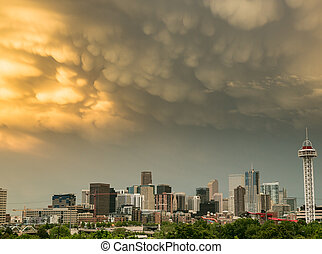 Dramatic Mammatus Clouds Over Denver Skyline at Sunset
