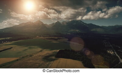 Dramatic mountain range, farm fields and forests - Aerial...
