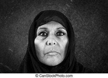 Dramatic muslim woman in bw