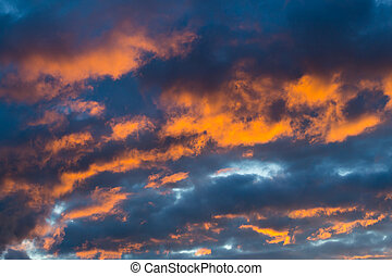 dramatic natural colorful orange sky cloudscape in dark