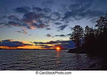Dramatic northern sunset. Lake Keret, North Karelia, Russia