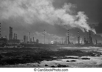 Dramatic oil refinery by the sea