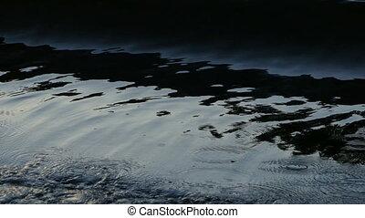 black waves crashing onto the shore - dramatic ominous black...