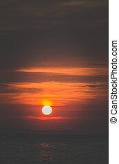 dramatic orange sunset by the sea