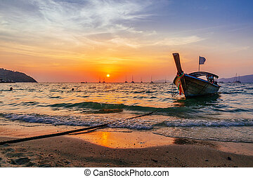 Dramatic orange sunset over a beach in Koh Lipe