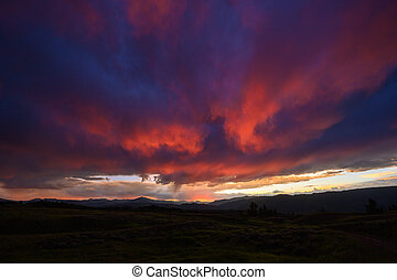Dramatic Pink Clouds in late sunset over Yellowstone
