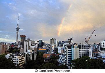 Dramatic rainbow in a rain cloud over Auckland skyline