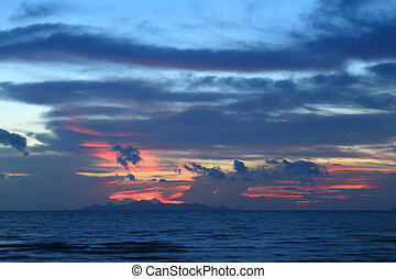 Dramatic red fire sky and deep blue sea at dusk,Thailand