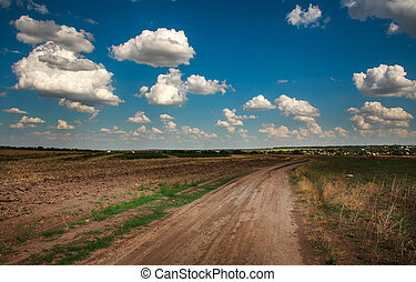 Dramatic scenery dirt road in countryside under sky