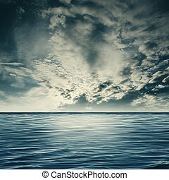 Dramatic sea, natural landscape with clouds and sea surface