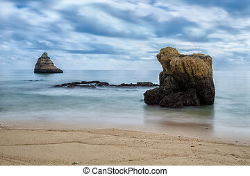 Dramatic seascape blurred waves. Portugal, Algarve.