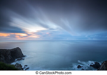 Dramatic seascape of blurred sky and waves Costa Vicentina ...