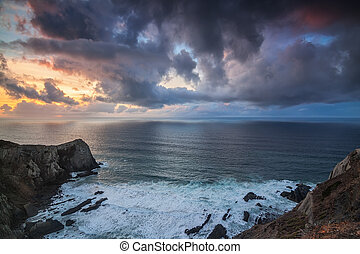 Dramatic seascape of the sunset, on rocks Costa Vicentina ...
