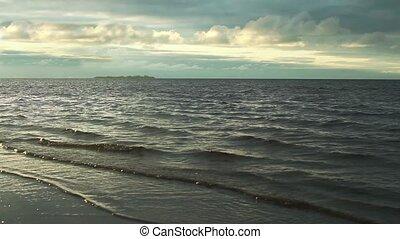 Dramatic seascape Sea waves running on beach