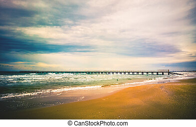 dramatic seascape with pier