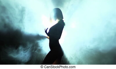 Dramatic Show - Backlit showgirl making a dramatic...