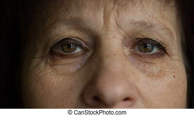 Dramatic sight of elderly woman - Eyes of elderly woman look...