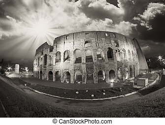 Dramatic sky above Colosseum in Rome. Night view of Flavian Amph