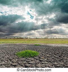 dramatic sky and cracked earth