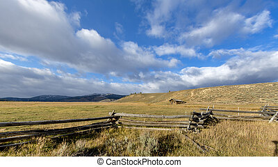 Dramatic sky and rustic old cabin in Idaho