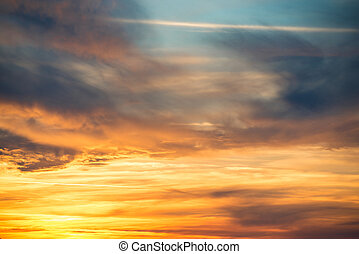 Dramatic sky at sunset with red, yellow, orange and blue...