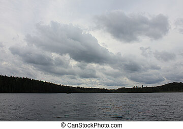 Dramatic sky over a small lake near Backefors, Sweden.